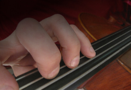 photo of fingers on cello
